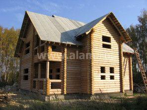Строительство дома из оцилиндрованного бревна.