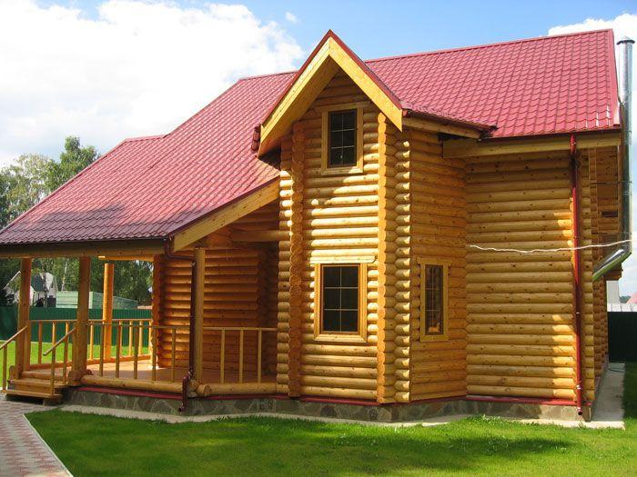 Загородный дом из бревна по индивидуальному проекту