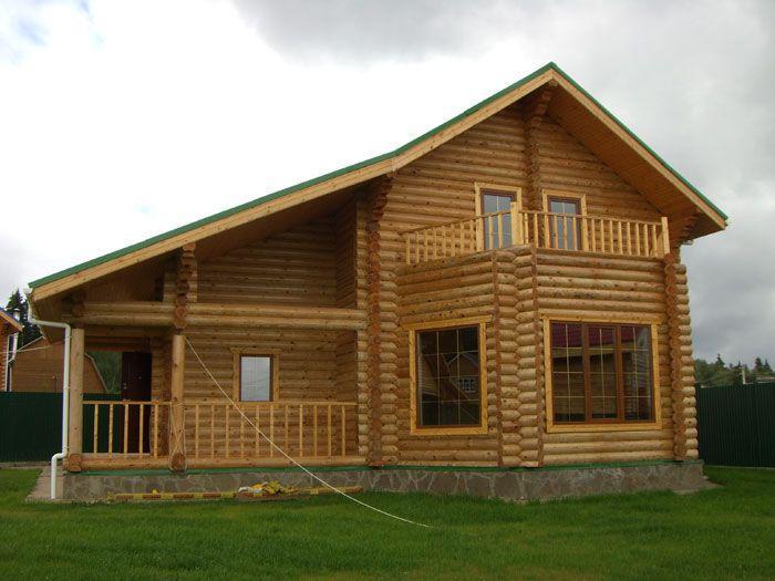Дом из оцилиндрованного бревна.Фото