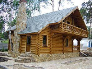 Деревянный дом из бревна с балконом ОБ-53